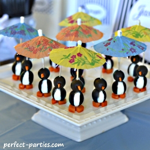 olive penguins with parasol