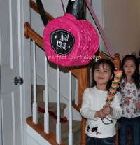 pink and black pinata