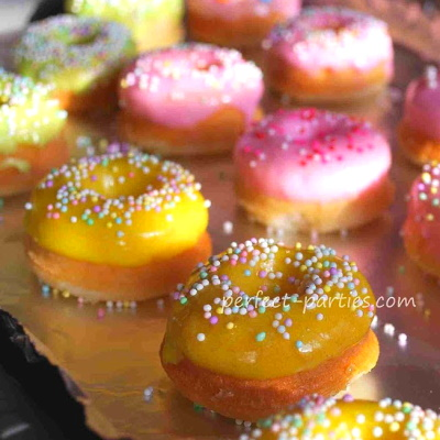 add the icing and sprinkles to each donut cupcake.