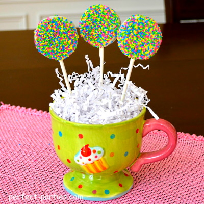Oreo Pops with white chocolate and sprinkles.