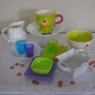 Penny Toss game...set up dishes, cups and containers for this carnival game.