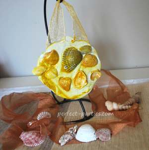 Using plaster of paris and shells, make this cute hanging.